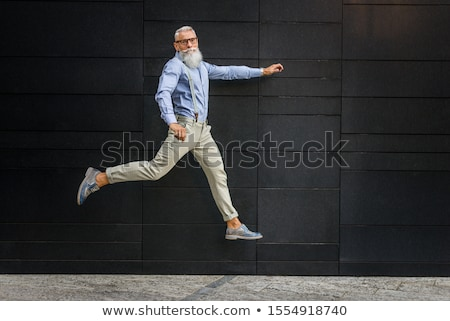 Cheerful senior grey-haired man in eyeglasses and shirt Stock photo © pressmaster