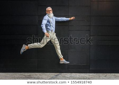 Cheerful senior grey-haired man in eyeglasses and shirt Stock photo © pressmaster