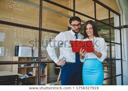 Szczęśliwy młodych kobiet papieru konsultacji kolega Zdjęcia stock © pressmaster