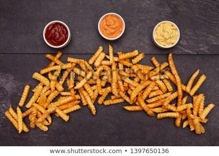 Patatine fritte buio tavola salsa varietà tre Foto d'archivio © lightkeeper