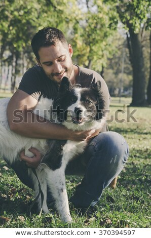 Man Playing with Pet, Male and Dog in Forest Park Stock photo © robuart