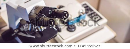 precision micrometer grinder polishing machine with a big optical microscope standing by Stock photo © galitskaya