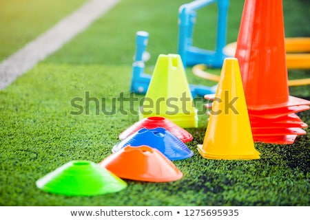 soccer training equipment on green artificial turf with training stock photo © matimix