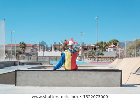 Scary clown odkryty za kolorowy Zdjęcia stock © nito