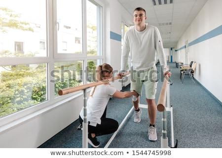 Genç yürüyüş rehabilitasyon spor hasar diz Stok fotoğraf © Kzenon