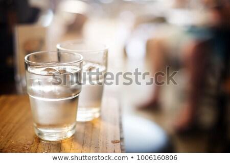 Glas voll Trinkwasser Licht gestreift Stock foto © dariazu