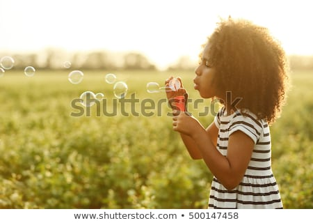 happy little african american girl with flowers stock photo © dolgachov