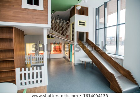 Slide, small house and net between them inside contemporary leisure center Stock photo © pressmaster