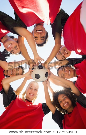 Low angle shot of a group of sports team forming a huddle Stock photo © matimix