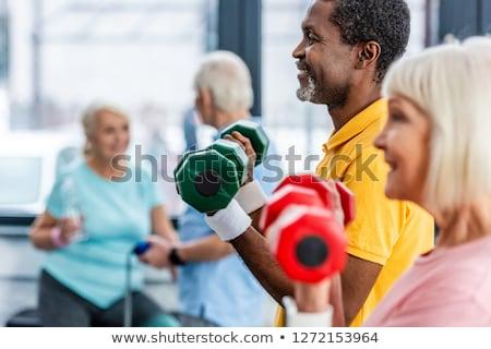 Obraz sportsmenka wykonywania silne Zdjęcia stock © deandrobot