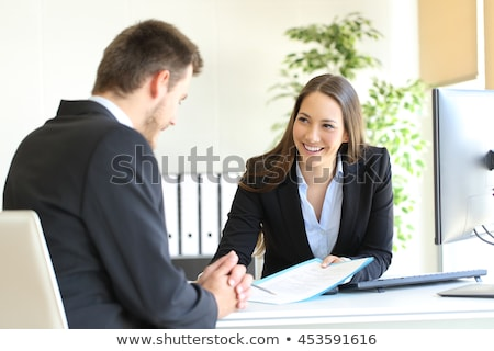 Two Businesspeople Working On Contract Paper Stock photo © AndreyPopov