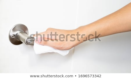 man opening a door using a disinfecting wipe Stock photo © nito