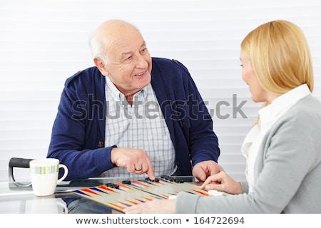 Supérieurs homme jouer maison de retraite couple échecs Photo stock © galitskaya
