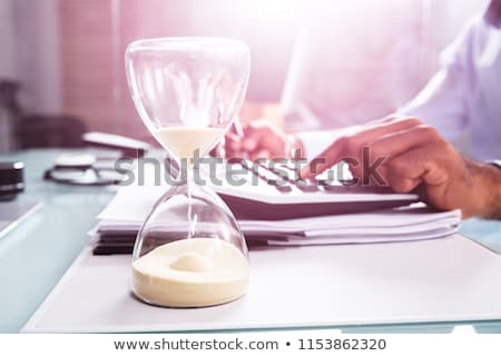 Late Invoice And Hourglass Deadline Working Stock photo © AndreyPopov
