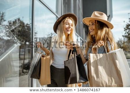 fashion shopping girl near shop stock photo © smeagorl