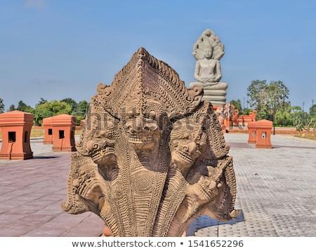 Buda cobra estátua escultura sete isolado Foto stock © smithore