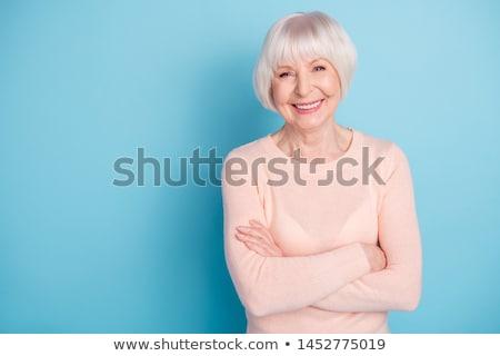 sonriendo · altos · mujer · de · negocios · armas · doblado · feliz - foto stock © dnsphotography