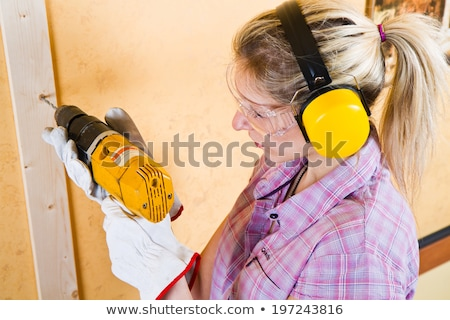woman posing with a power drill stock photo © photography33