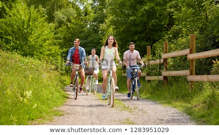 Teenagers out cycling together Stock photo © photography33