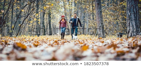 couple taking a stroll in autumn stock photo © photography33