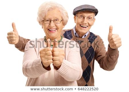 radosny · starszy · człowiek · stwarzające · ręce · kieszeni - zdjęcia stock © stockyimages