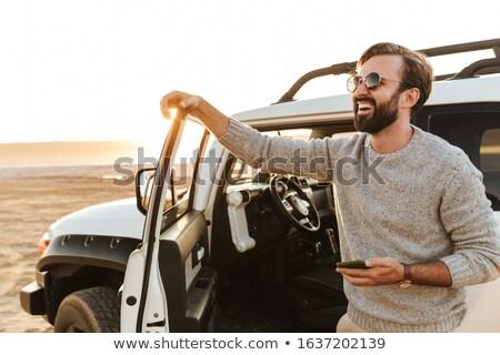 Mosolyog férfi telefon part iroda munka Stock fotó © photography33