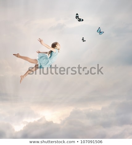 Stock photo: Little Girl Flying at Twilight