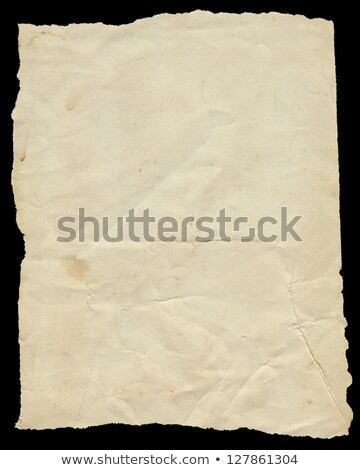 Old vintage yellowing torn paper isolated on black. Stock photo © latent