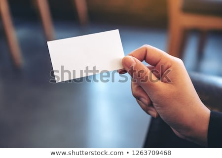 Foto stock: Hands With Blank Card And Notebook