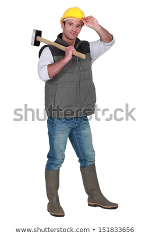 Tradesman carrying a mallet and wearing a hard hat and rubber boots Stock photo © photography33