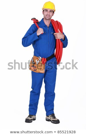 Plumber stood with plastic coil Stock photo © photography33