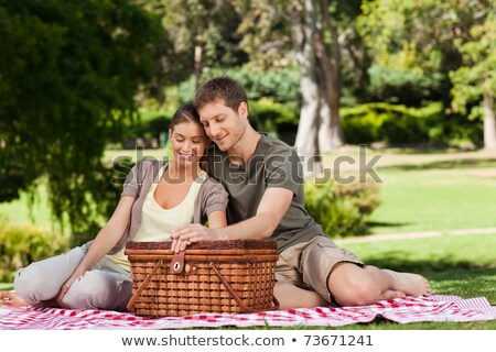 Stock photo: Couple picnicking in the countryside