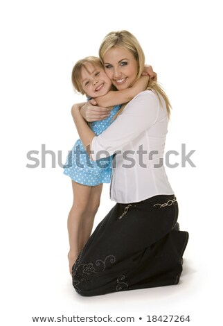 Cute daughter hugging her mom. Casual shot Stock photo © stockyimages