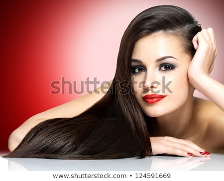 Beautiful woman brunette - long hairstyle on black background Stock photo © gromovataya