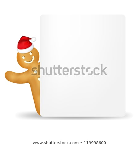 gingerbread man with santa hat and blank gift tag stock photo © adamson
