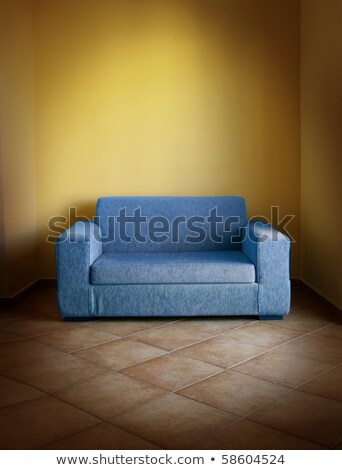 brown vintage sofa on terracotta tiled floor in yellow room Stock photo © shutswis