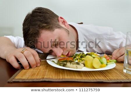 Man sleeping at the dinner table Stock photo © stevanovicigor