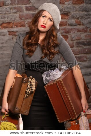 boldogtalan · nő · nehéz · bőrönd · fényes · kép - stock fotó © dolgachov