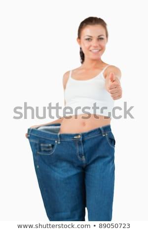 Portret kobieta spodnie kciuk Zdjęcia stock © wavebreak_media
