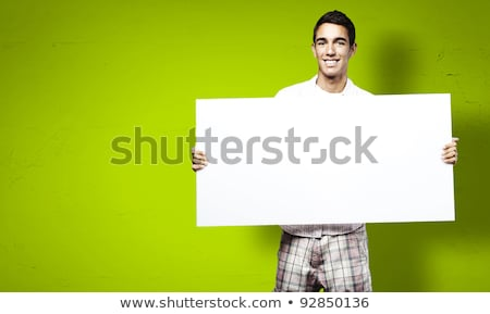 happy business people holding a poster against white background stock photo © wavebreak_media