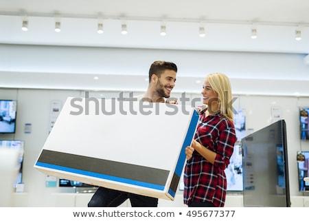 Achat télévision vendeur homme couple Photo stock © artisticco
