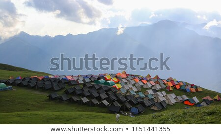 Tents at alpine meadow Stock photo © Rybakov