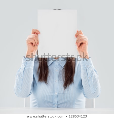Portrait of business woman holding blank paper sheet in front of Stock photo © HASLOO