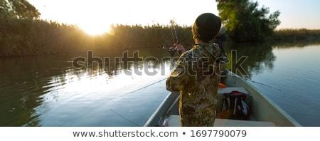 Young angler fishing Stock photo © Pruser