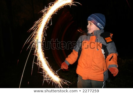 Stock photo: child with moving sparkler