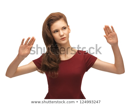 girl in red dress working with something imaginary Stock photo © dolgachov