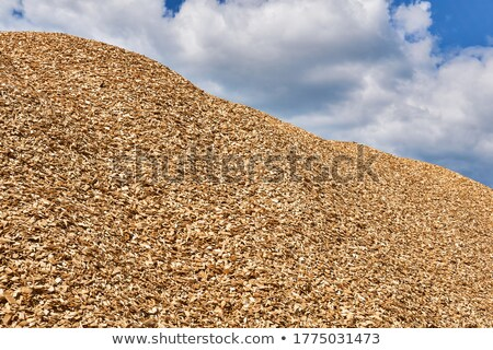 Pile of Woodchip against Blue Sky Stock photo © tainasohlman