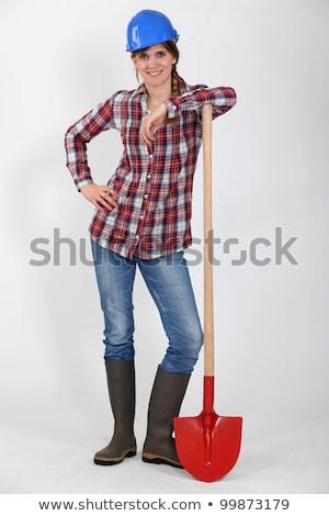 Female bricklayer resting on shovel Stock photo © photography33