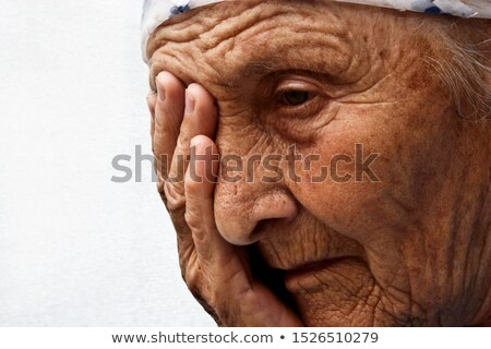 Woman With Tears Dripping from Her Eyelashes Stock photo © tobkatrina