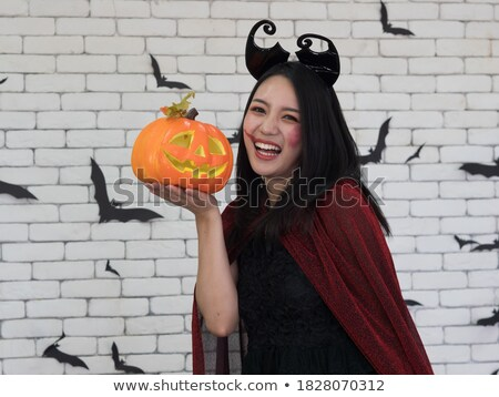 pretty witch holding jack o lantern oranges stock photo © elisanth